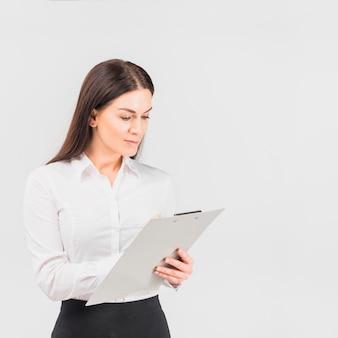 Mulher negócio, escrita, ligado, área de transferência