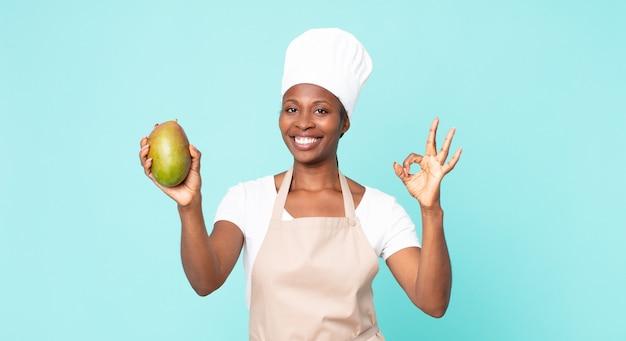 Mulher negra chef adulta afro-americana com uma manga