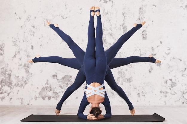 Mulher praticando ioga, realizando um exercício asana invertido de cabeceira e shirshasana com diferentes posições das pernas em uma esteira perto da parede, o símbolo do sol