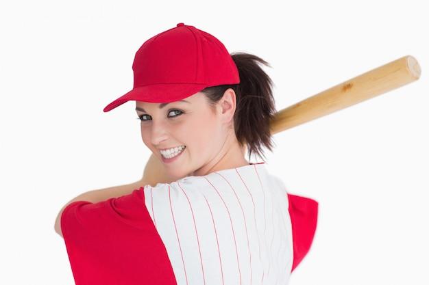Mulher pronta para jogar com taco de beisebol