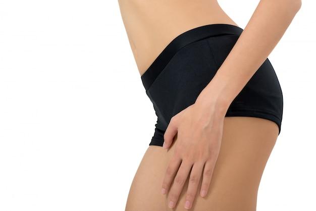 Mulher segura, com, massaging, dela, coxa, em, dor, área, isolado, branco