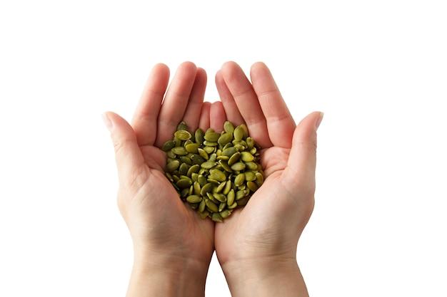 Mulher segura, cru, unshelled, sementes abóbora