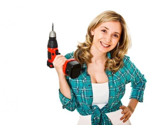 Mulher sorridente trabalhador com broca