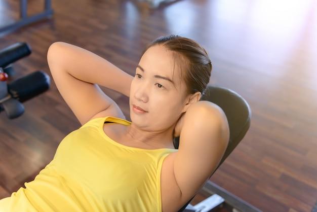 Mulher, trabalhando, em, condicão física
