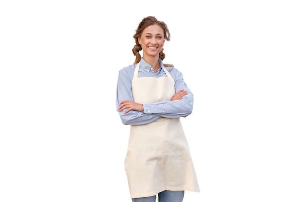 Mulher vestida de avental com fundo branco mulher de meia-idade, caucasiana, empresária uniformizada