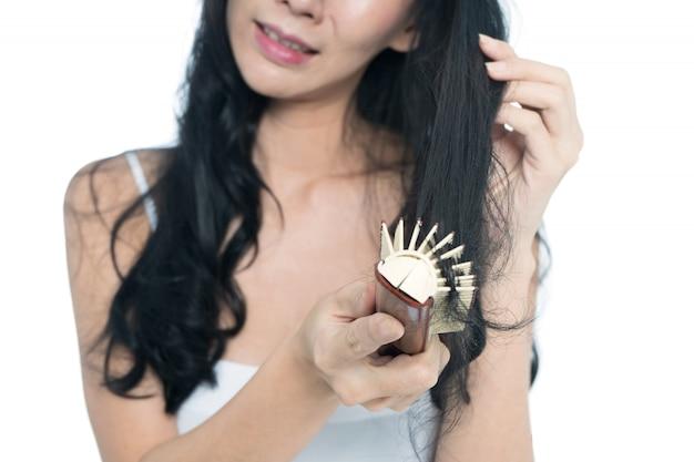 Mulheres, com, problema cabelo, segurando cabelo, em, mão