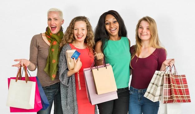 Mulheres que compram o conceito de shopaholic da consumição da despesa