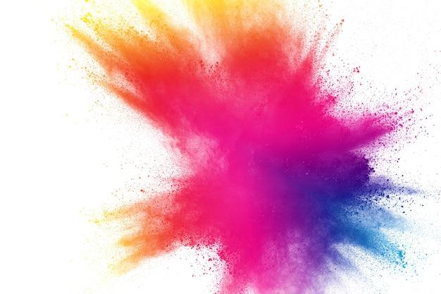 Multi explosão do pó da cor isolada no fundo branco.