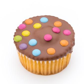 Múltiplos muffins coloridos decorados