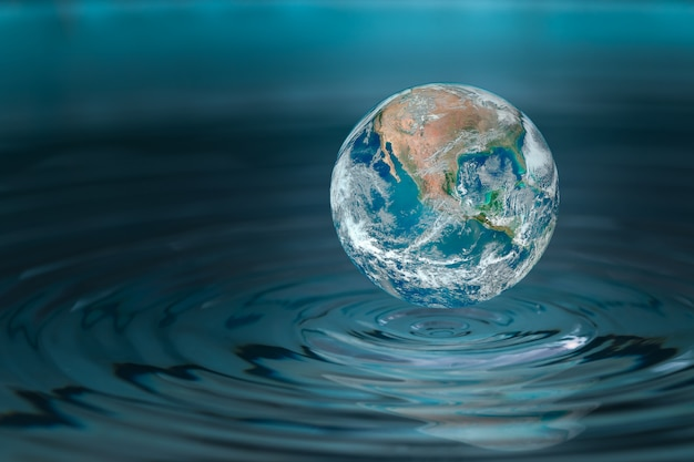 Mundo caindo em uma gota de água, conceito para puxar água e conservador.