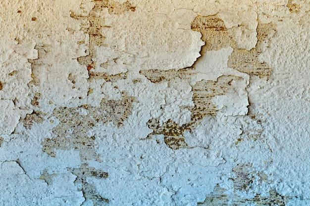 Muro de cimento rachado para o fundo.