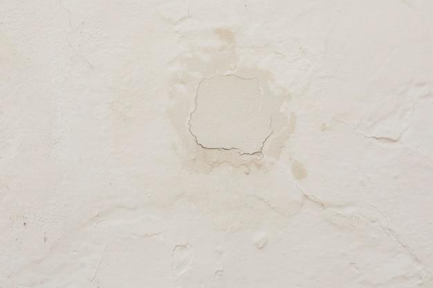 Muro de concreto com gesso e rachaduras