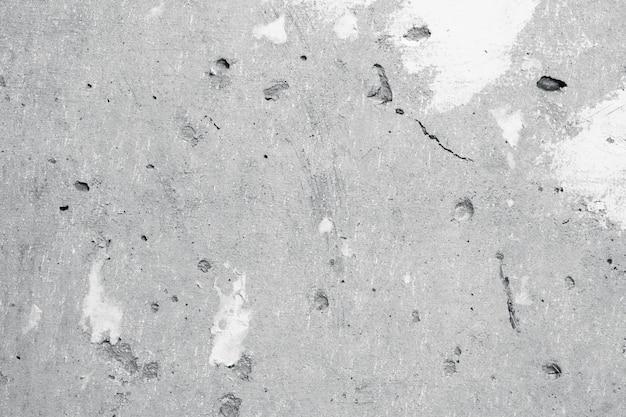 Muro de concreto com manchas de massa branca. textura cinza abstrata