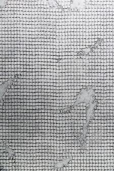 Muro de concreto com superfície geométrica