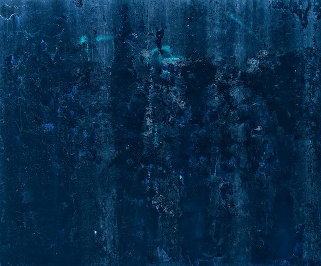 Muro de concreto sujo vintage em tons de azuis.
