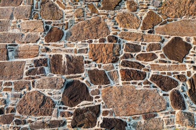 Muro de pedra de paralelepípedos como pano de fundo