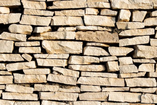 Muro de pedras. lajes de pedra. pode ser usado como pano de fundo de textura
