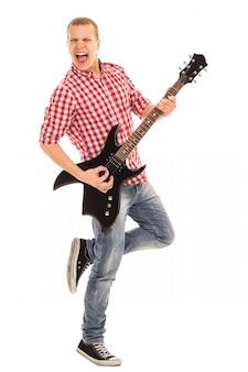 Música. jovem músico com uma guitarra