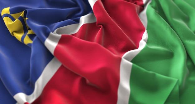 Namíbia flag ruffled beautifully waving macro close-up shot