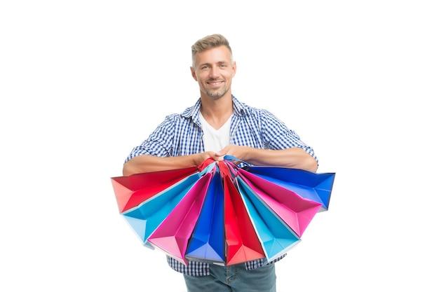 Não resistiu à tentação. venda total. homem positivo, gostando de fazer compras. homem feliz com branco isolado de sacolas de compras. cara animado fazendo compras. felicidade de compra. boa compra. presentes para férias.