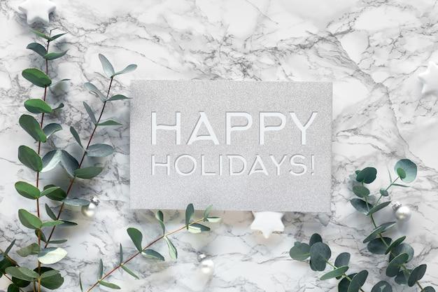 Natal, ano novo quadro de inverno com galhos de eucalipto frescos e bugigangas brancas, enfeites com estrelas. vista plana leiga, superior em fundo de mármore branco. texto