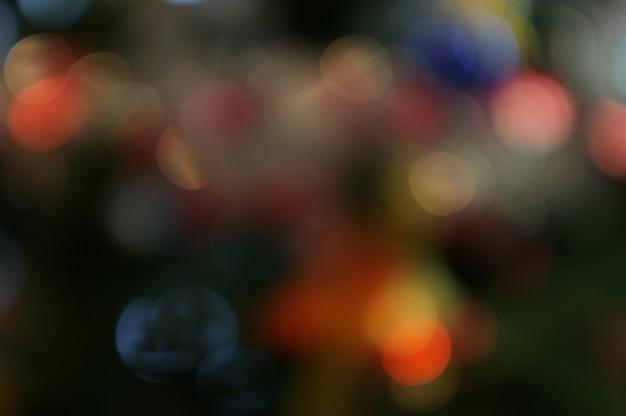 Natal e feliz ano novo no bokeh turva fundo de banner de árvore de natal
