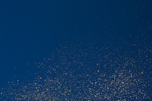 Natal glitter dourados sobre fundo azul. textura abstrata de férias