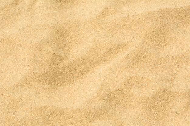 Natureza da areia na praia como o fundo.