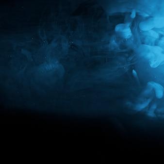 Neblina azul abstrata na escuridão