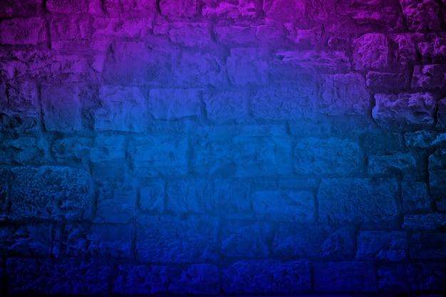 Néon colorido fundo da parede de tijolo de pedra calcária