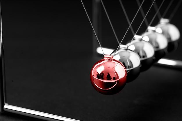 Newtons cradle balanceamento de bolas, conceito de negócio