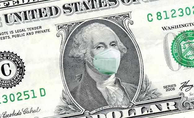 Nota de dólar com máscara para coronavírus