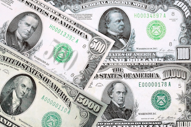 Notas de alta denominação do dólar americano, um plano de fundo