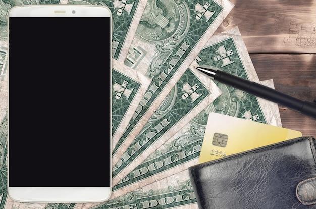 Notas de dólar americano e smartphone com bolsa e cartão de crédito