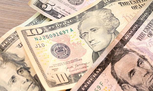 Notas de dólar americano em fotografia de close