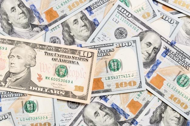 Notas de dólar americano. fundo de notas de cem dólares. vista superior do conceito de negócio em plano de fundo com espaço de cópia.