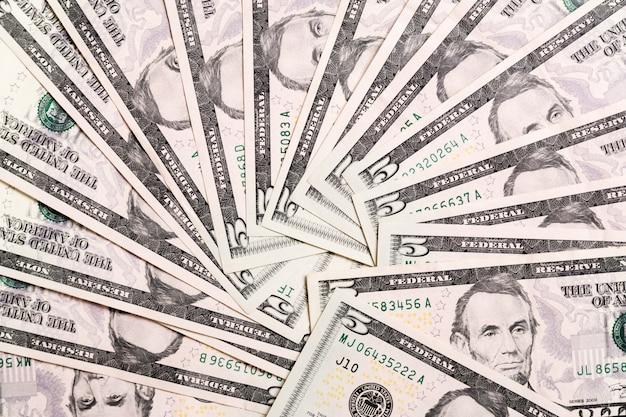 Notas de dólar dos eua. fundo de notas de cem dólares. vista superior do negócio em fundo com copyspace