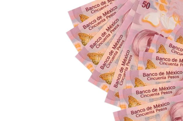 Notas de pesos mexicanos na superfície branca