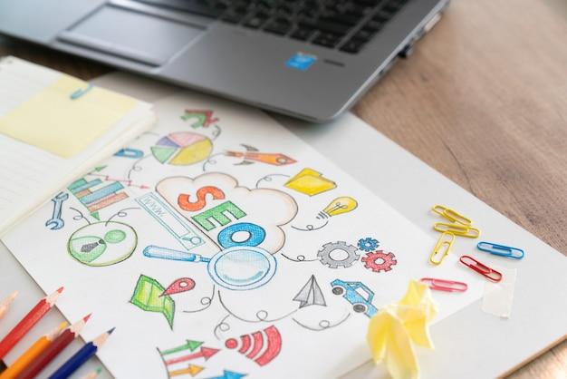 Notebook com portagens e notas sobre seo