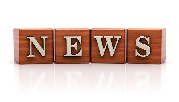 Notícias escritas em cubos de madeira
