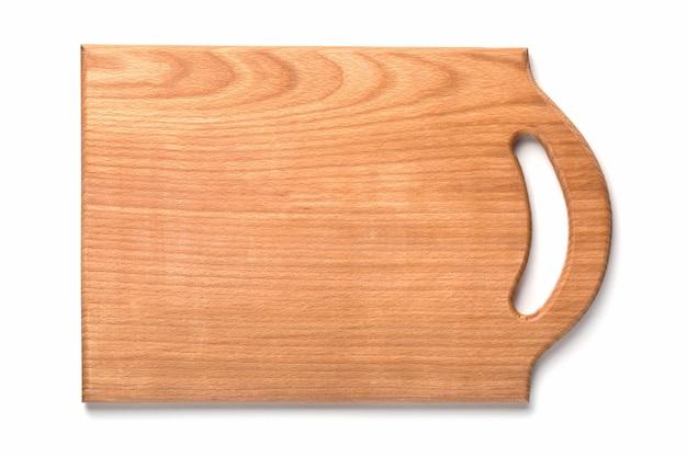 Nova placa de corte de madeira retangular isolada no fundo branco. vista do topo. maquete para projeto de alimentos.