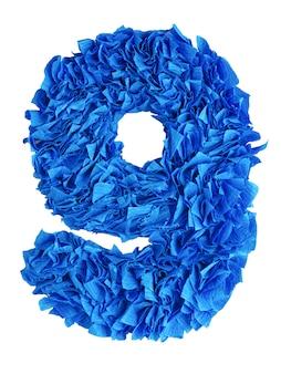 Nove, número handmade 9 de azuis pedaços de papel isolado no branco