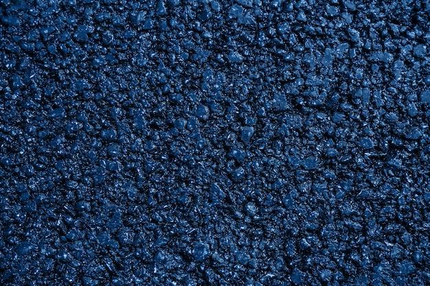 Novo plano de fundo texturizado de asfalto azul plano de perto