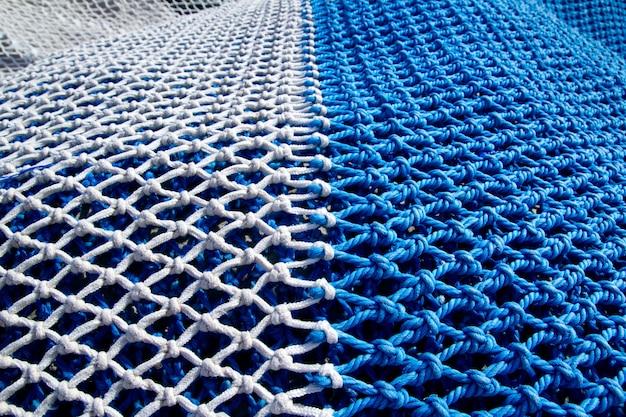 Ntes de pesca azul e branco com nós de corda