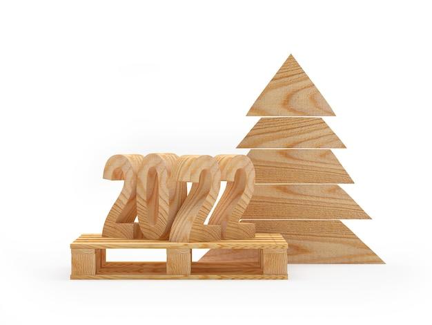 Número de madeira do ano novo em um palete com uma árvore de natal