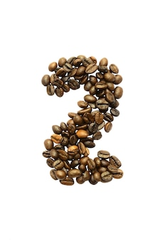 Número dois de grãos de café isolados no fundo branco