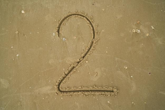 Número escrito na areia