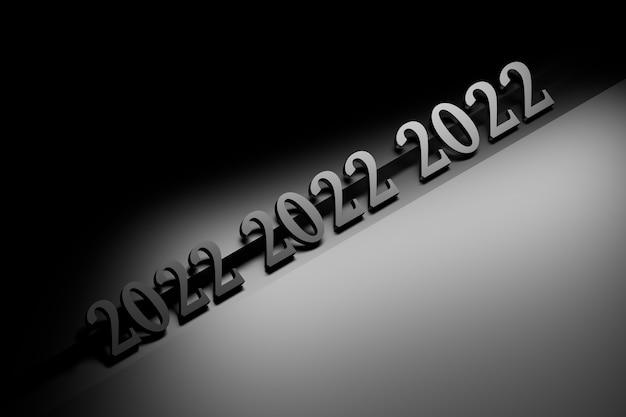Números grandes e em negrito de ano novo de 2022 em preto na superfície preta
