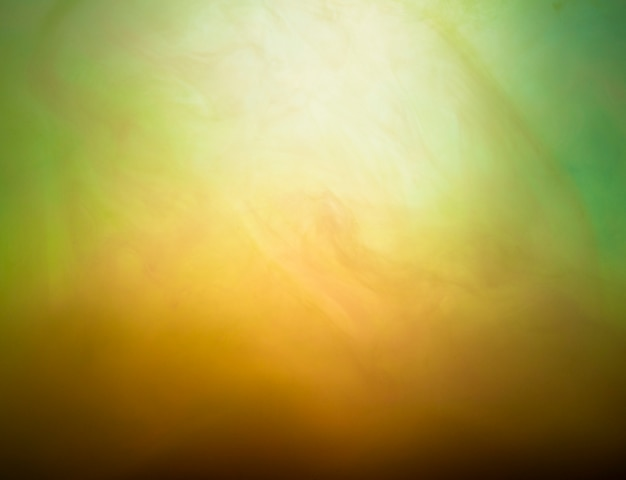 Nuvem abstrata de neblina em verde e amarelo
