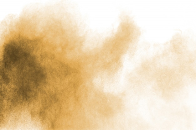 Nuvem de poeira marrom. partículas marrom salpicadas sobre fundo branco